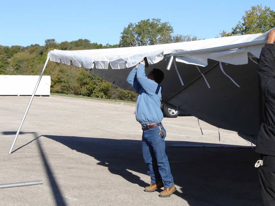 Raise one side of the tent and strap the tent top to the frame & INSTALLATIONS - Marquee Event Rentals