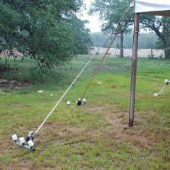 Drive stakes into the ground at every leg. Stake bars at seams and 4 corners